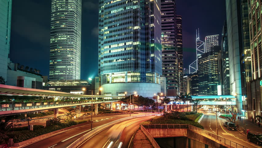 Roads with car trails in Hong Kong financial district at night. Scenic view of big illuminated city with skyscrapers and fast moving traffic. Colourful 4K Time lapse.  | Shutterstock HD Video #22446310