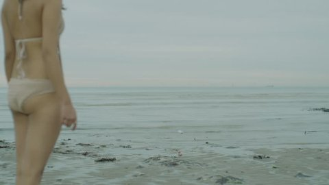 Girl throws message in a bottle at the beach, powerful and thought provoking filmed on Sony FS5, Filmic, Cinematic