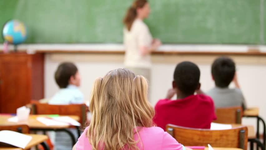 Teacher wiping the chalkboard in the classroom | Shutterstock HD Video #2247796