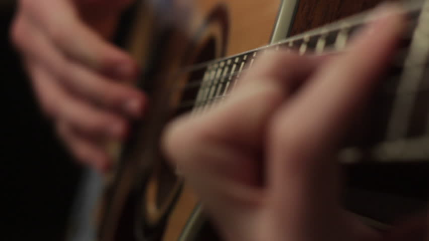 Playing on the acoustic guitar. Musical instrument with guitarist hands | Shutterstock HD Video #22478680