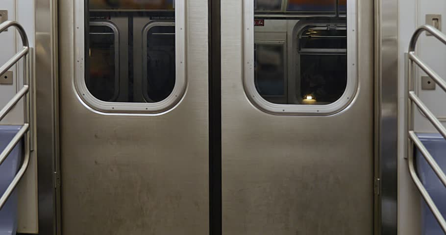 An interior shot of closed New York City subway doors as the car approaches the platform.   | Shutterstock HD Video #22512280