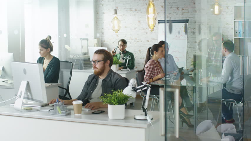 Weekday in a Busy Creative Bureau. Office People Working at Their Personal Computers, Talking on the Phone. Man Joins Coworkers at Conference Table. Shot on RED EPIC (uhd). | Shutterstock HD Video #22521115