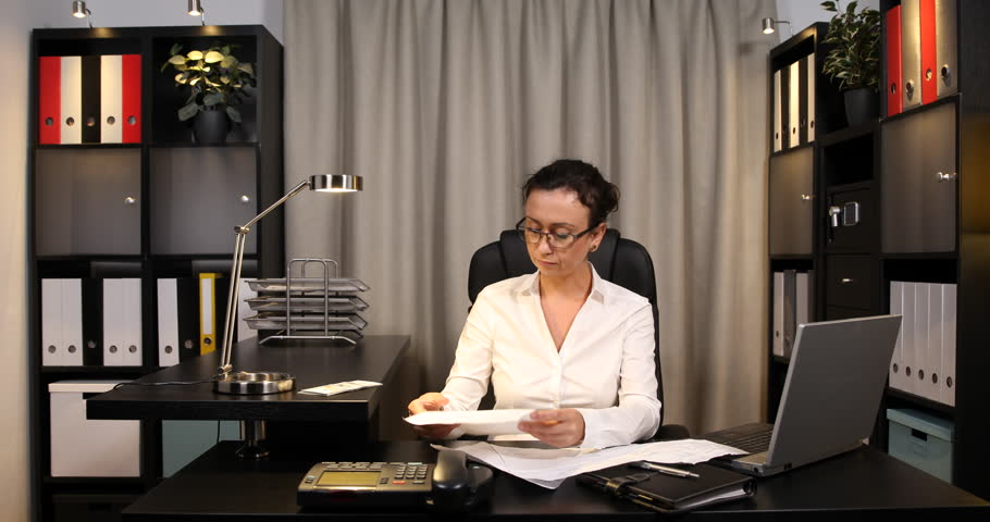 Business Woman Examining Invoices Count Usd Bill Payments Incapacity Office Debt | Shutterstock HD Video #22577080