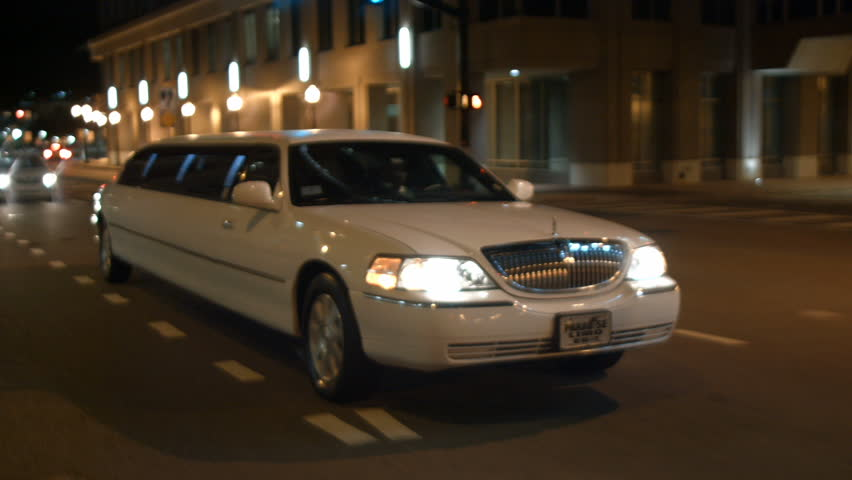 limo drives through urban city night limousine | Shutterstock Video #22597477