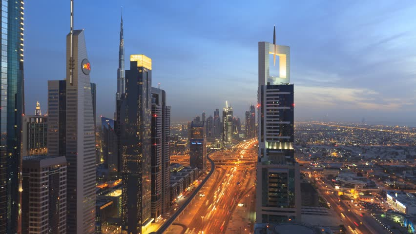 DUBAI, UNITED ARAB EMIRATES - MARCH 14: Time lapse, dusk to night transition of Dubai cityscape on Sheikh Zayed Road, the busiest road in the city on March 14, 2011 in Dubai, United Arab Emirates.