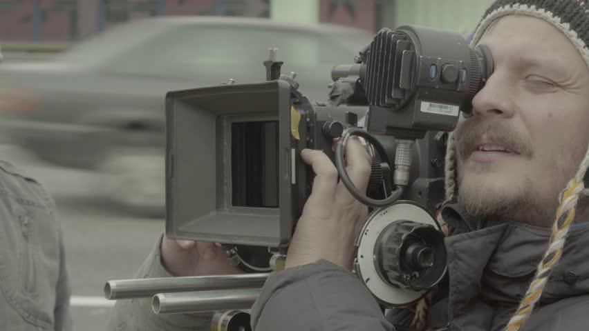 KYIV, UKRAINE  –  NOVEMBER 18, 2016. Man the cameraman shoots the movie | Shutterstock HD Video #22657810