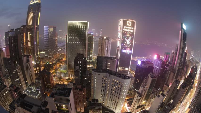 Hong Kong, China - december 10, 2016: Aerial view time lapse of Hong Kong skyscrapers at night from a sky Bar, in Wan Chai, Hong Kong island. Fisheye view. | Shutterstock HD Video #22660540