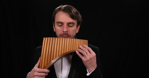 Talented Musician Play Pan Flute Romanian Instrument Man Performing at Panpipes