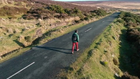 A man is hiking via Wicklow mountains. Aerial view 4K UHD