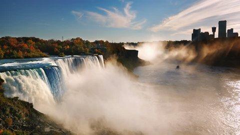 Niagara River at sunset near Niagara Falls. The sun's rays illuminate the waterfall, the ship sails on the river. ProRes HQ 422 10 bit video