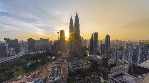 KUALA LUMPUR - FEBRUARY 12 2016: Beautiful golden sunset of Kuala Lumpur skyline overlooking the national landmarks, the Petronas Towers and KL Tower on February 12, 2016 in Kuala Lumpur, Malaysia.