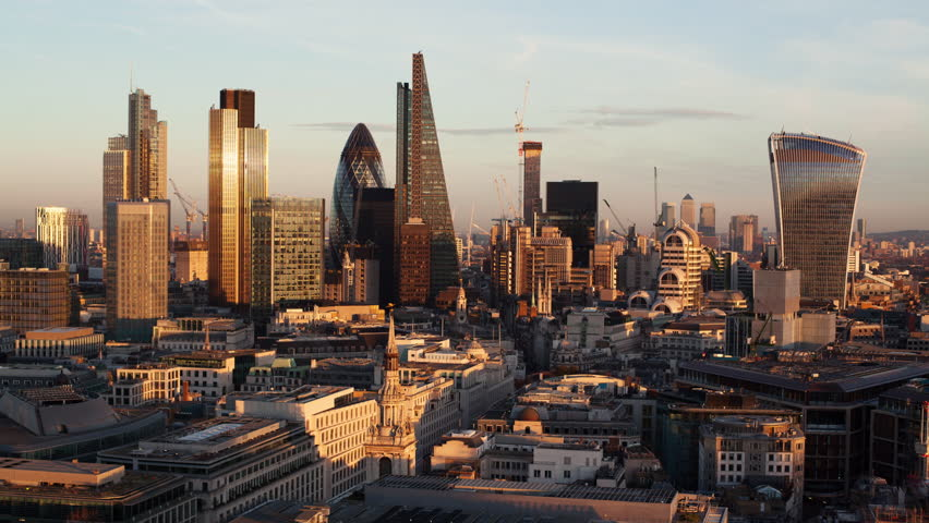 Establishing shot elevated view - day to night time-lapse of the business district of London