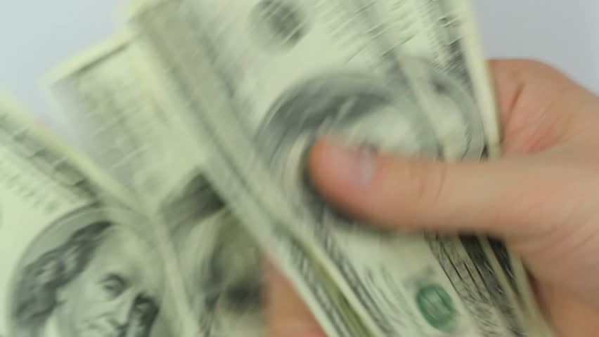 Counting money, Seamless loop video of male hands counting a lot of one hundred dollar bills