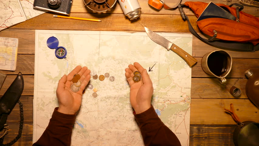 Traveler counting coins of different countries. Top view. | Shutterstock HD Video #22790098