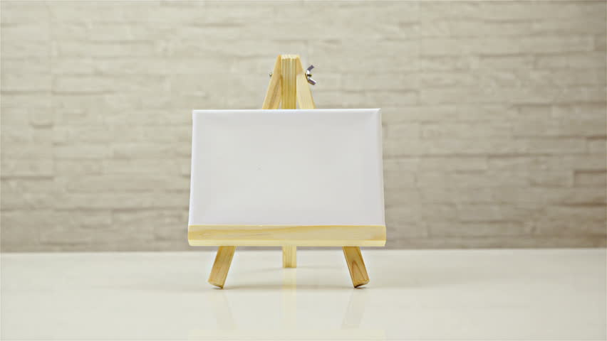 Wooden Easel With Blank Canvas Loop Rotate On White