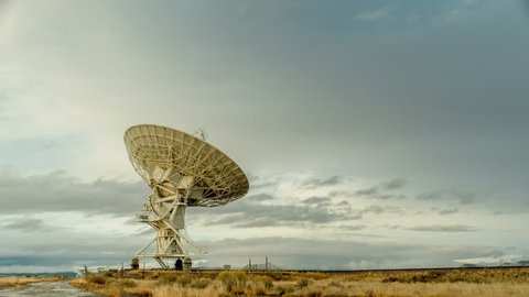 Radio Telescope Searches Sky. Time-lapse of a radio telescope dish at the Karl G. Jansky Very Large Array (VLA) near Socorro, New Mexico as it moves adjusts to the sky above.