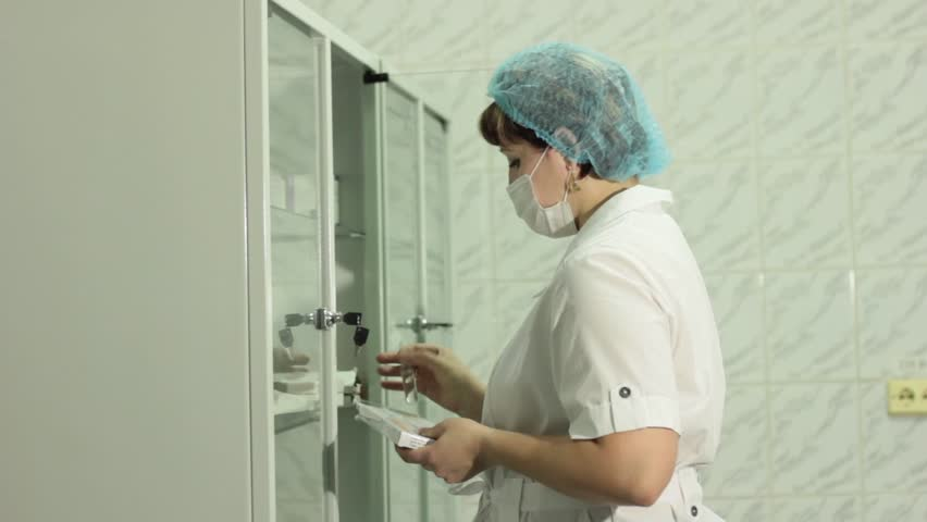 Woman doctor takes medicines from the Cabinet | Shutterstock HD Video #22827010