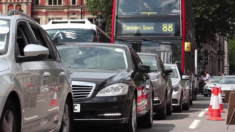 Great Britain, London, 11th of July 2015. Traffic in London with a lot of cars and red bus 88 going to Camden Town.