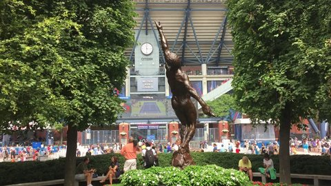 FLUSHING, NEW YORK - SEPT 1, 2016: Arthur Ashe Statue stands in front of USTA at Flushing Meadows at famed tennis tournament in Queens.
