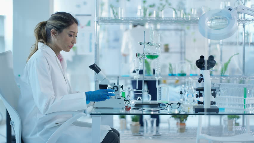 4K Research scientists studying plant life in laboratory Dec 2016-UK #22857160