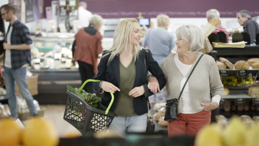 4K Senior lady & her adult granddaughter buying groceries in the supermarket Dec 2016-UK | Shutterstock HD Video #22858390