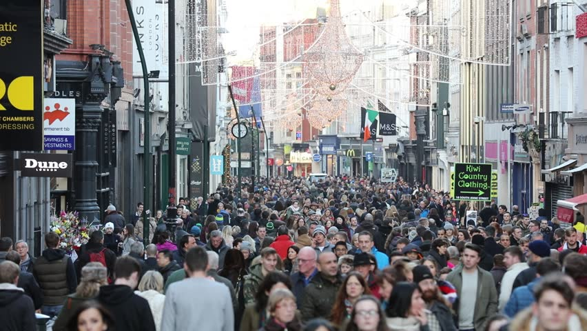 DUBLIN, IRELAND - DECEMBER 28: Endless crowd walking on the Grafton Street in Dublin, Ireland. Grafton Street is regarded the 5th most expensive shopping street in the World