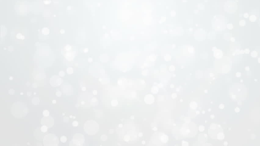 Beautiful glowing silver white bokeh background with flickering light particles.
