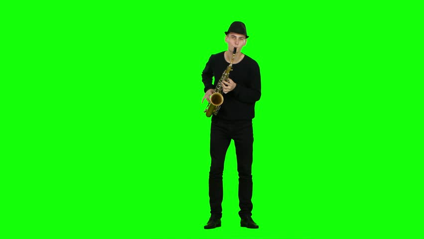 Green screen. Blues melodies performed by musician on the saxophone
