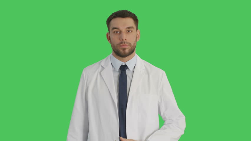 Medium Shot of a Handsome Medical Practitioner Crossing Arms on His Chest and Smiling Warmly. Shot on a Green Screen Background. Shot on RED Cinema Camera 4K (UHD). | Shutterstock HD Video #22950247