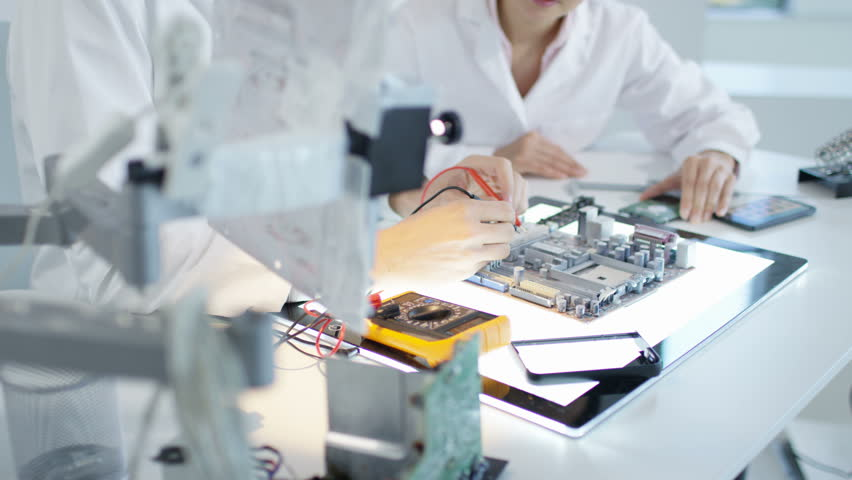 Electronics Lab Test : Workers are manufacturing circuit boards in electronics