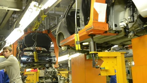 TOGLIATTI - SEP 30, 2011: People work at assembly of cars LADA Granta on conveyor of factory AutoVAZ, on September 30, 2011 in Togliatti, Russia.
