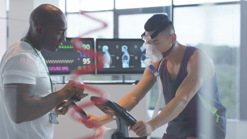 4K Sports professional analyzing man's fitness levels with hi tech equipment Dec 2016-UK | Shutterstock HD Video #22984000