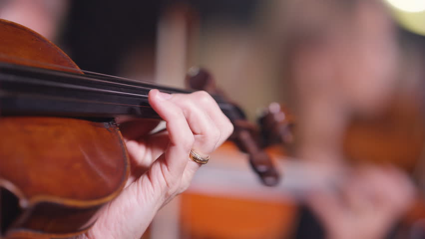 4K Symphony orchestra during a performance with focus on violinists Dec 2016-UK | Shutterstock HD Video #22987840