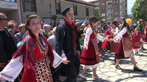 BANSKO, BULGARIA - 07 MAY, 2016: Folklore festival in Bansko, Bulgaria. The folklore group from Bulgaria dressed in traditional clothing is preforming Bulgarian national dances