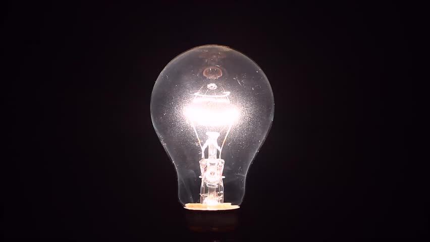Light bulb slowly dimming isolated on a black background | Shutterstock HD Video #22993750