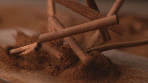 Cinnamon sticks falling into powdered cinnamon in super slow motion, shot on Phantom Flex 4K