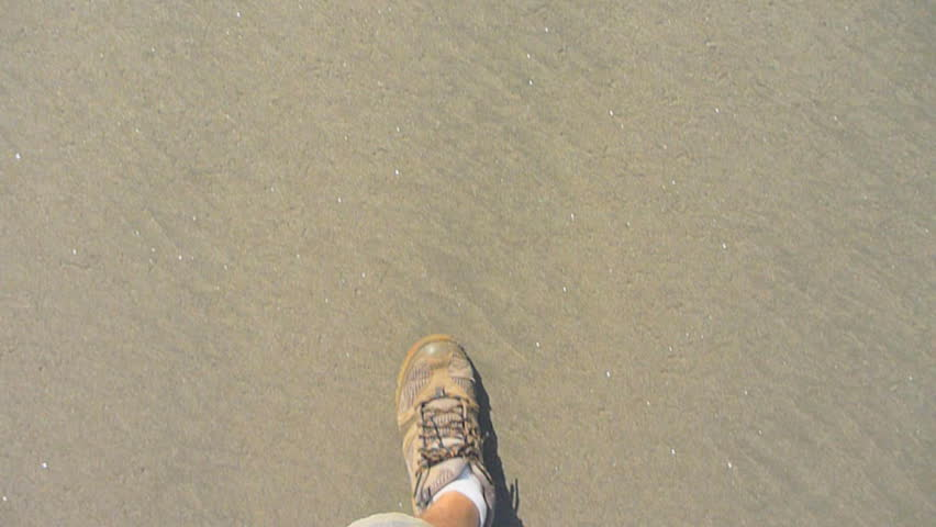 Man hikes on sandy beach point of view. | Shutterstock HD Video #2301380