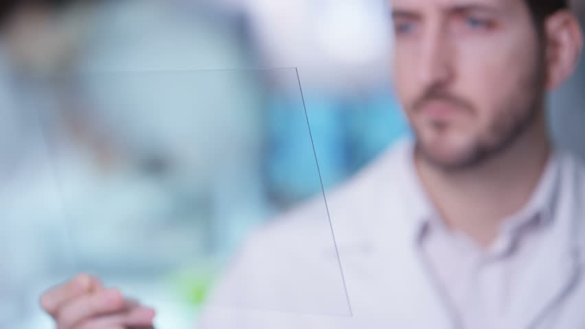 4K Scientist holding piece of clear material & using as interactive touch screen Dec 2016-UK | Shutterstock HD Video #23020450