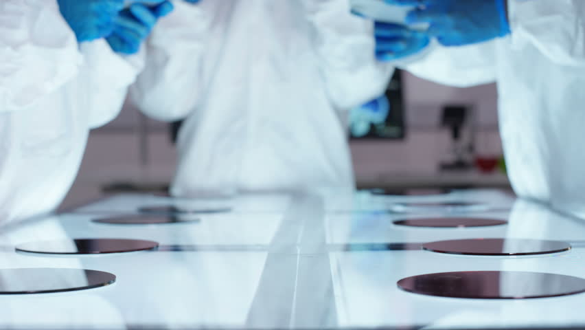 4K Scientific research team wearing full body suits in sterile lab Dec 2016-UK | Shutterstock HD Video #23021530