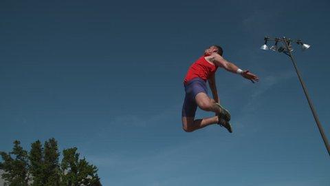 Track athlete doing long jump in super slow motion, shot on Phantom Flex 4K