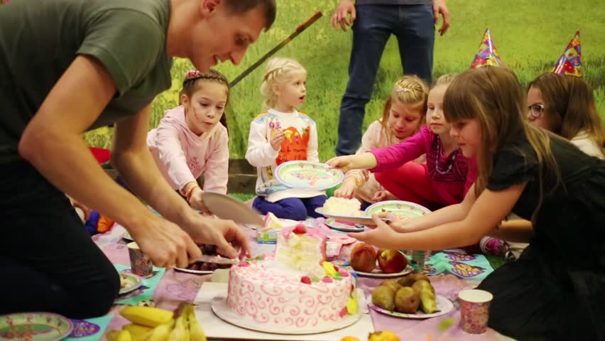 MOSCOW RUSSIA DECEMBER 13 2015 Man Cuts A Big Cake And Puts It
