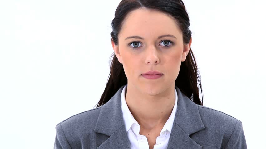 Brunette woman looking at the camera is speaking against white background
