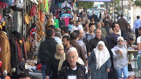 AMMAN, JORDAN - NOVEMBER 2016: Busy shopping street in central Amman, Jordan