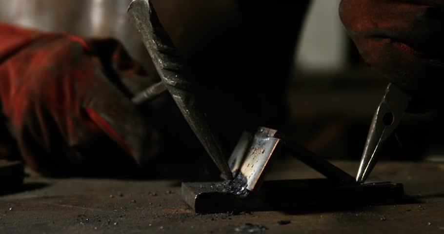 Hands of welder working on a piece of metal in workshop | Shutterstock HD Video #23130130