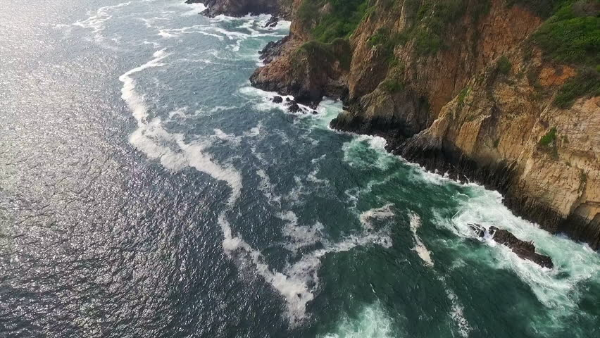 Aerial shot of the ocean in La Quebrada Acapulco Guerrero M\x8Exico