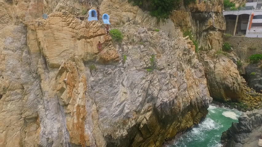 Aerial shot of people watching the divers prepairing their jump in La Quebrada Acapulco, Guerrero Mexico