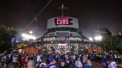 Chicago, Illinois - October 29th, 2016: Behind historic Wrigley Field during game 4 of the 2016 Major League Baseball World Series, corner of Waveland and Sheffield. Cubs vs. Indians 4K time lapse