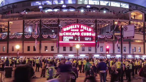 Chicago, Illinois - October 29th, 2016: Historic Wrigley Field during game 4 of the 2016 Major League Baseball World Series at the corner of Clark and Addison. Cubs vs. Indians 4K time lapse zoom out