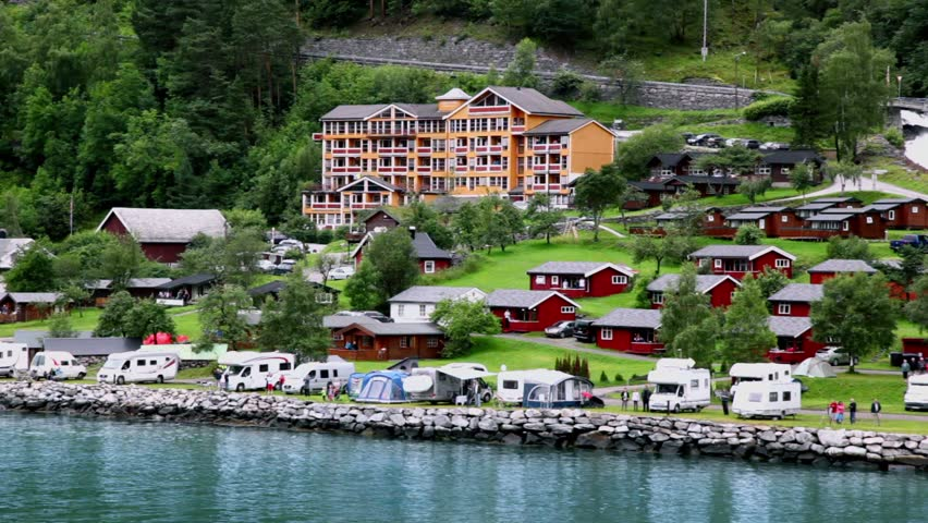 Geiranger June 28 Grande Fjord Hotel In Coastal Village Under Mountain With Forest On