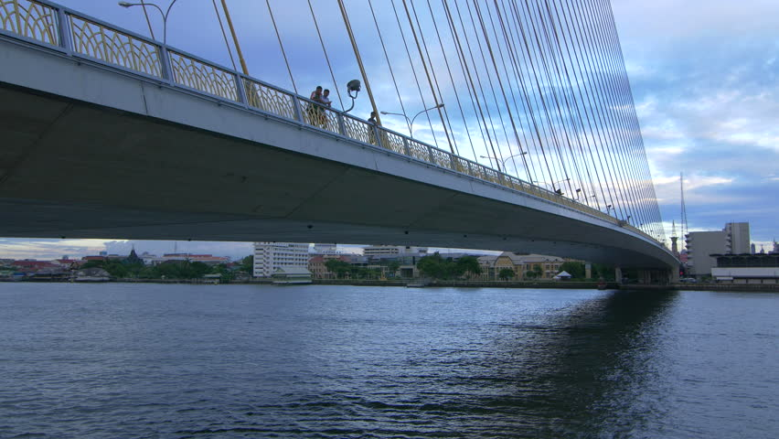Arial view on traffic on the cable-stayed bridge Rama VIII through the Chao Phraya River, Bangkok, Thailand #23189950